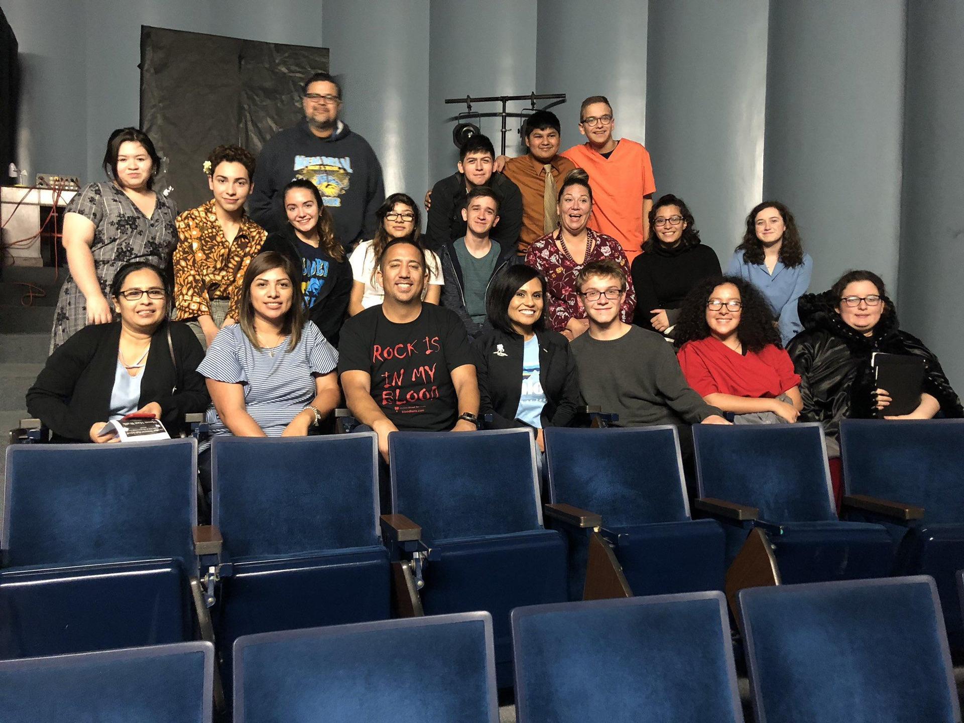staff group picture in auditorium