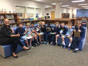 Second graders and their teacher Margaret Daniel enjoy the new story center in the Taylor Media Center.