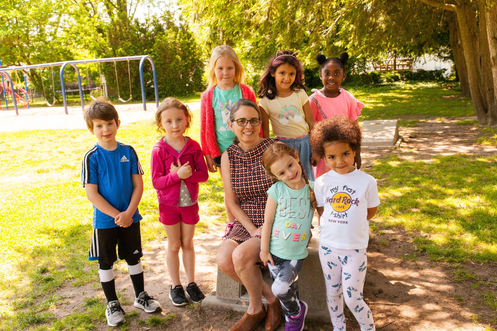 Head of School with Preschool and Pre-K on playground