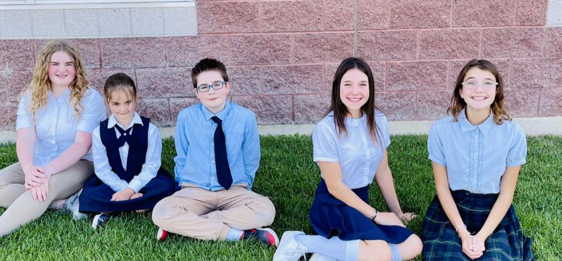 legacy prep best charter school in utah give children sitting on the grass