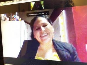 Mom smiling at zoom meeting