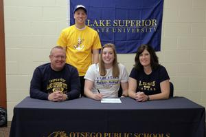 Matti Rayman with her parents and brother at her signing.