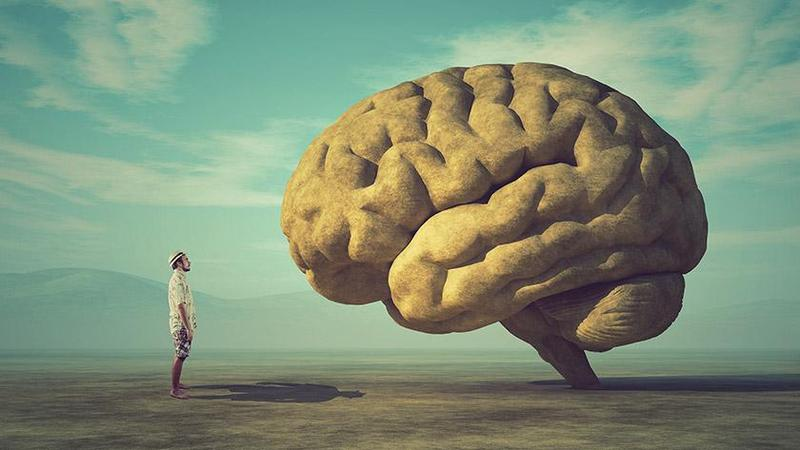 A painting of a man staring at a huge brain.
