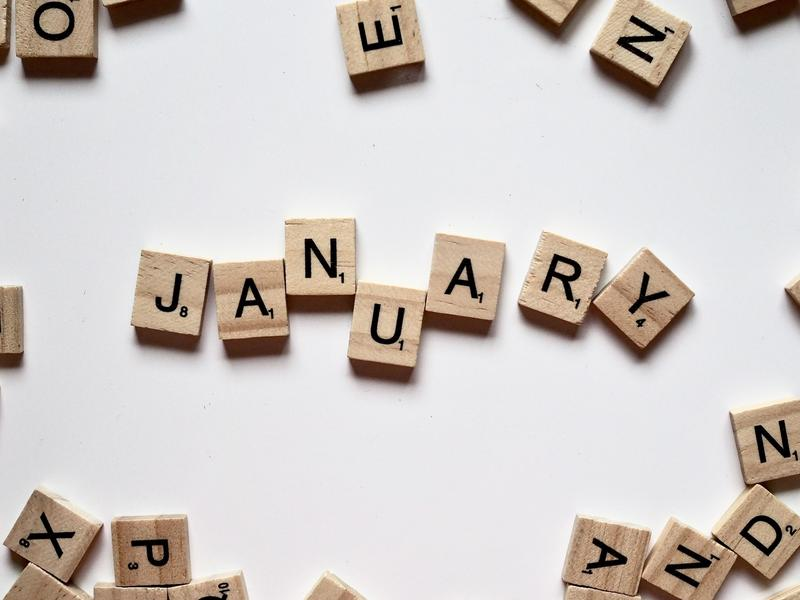 Scrabble letters spelling the word January
