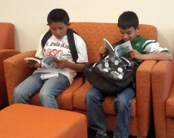 SVA students reading on couch
