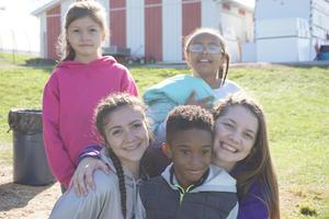 photo of OLSH students with children from Mooncrest at Janoski's Farm