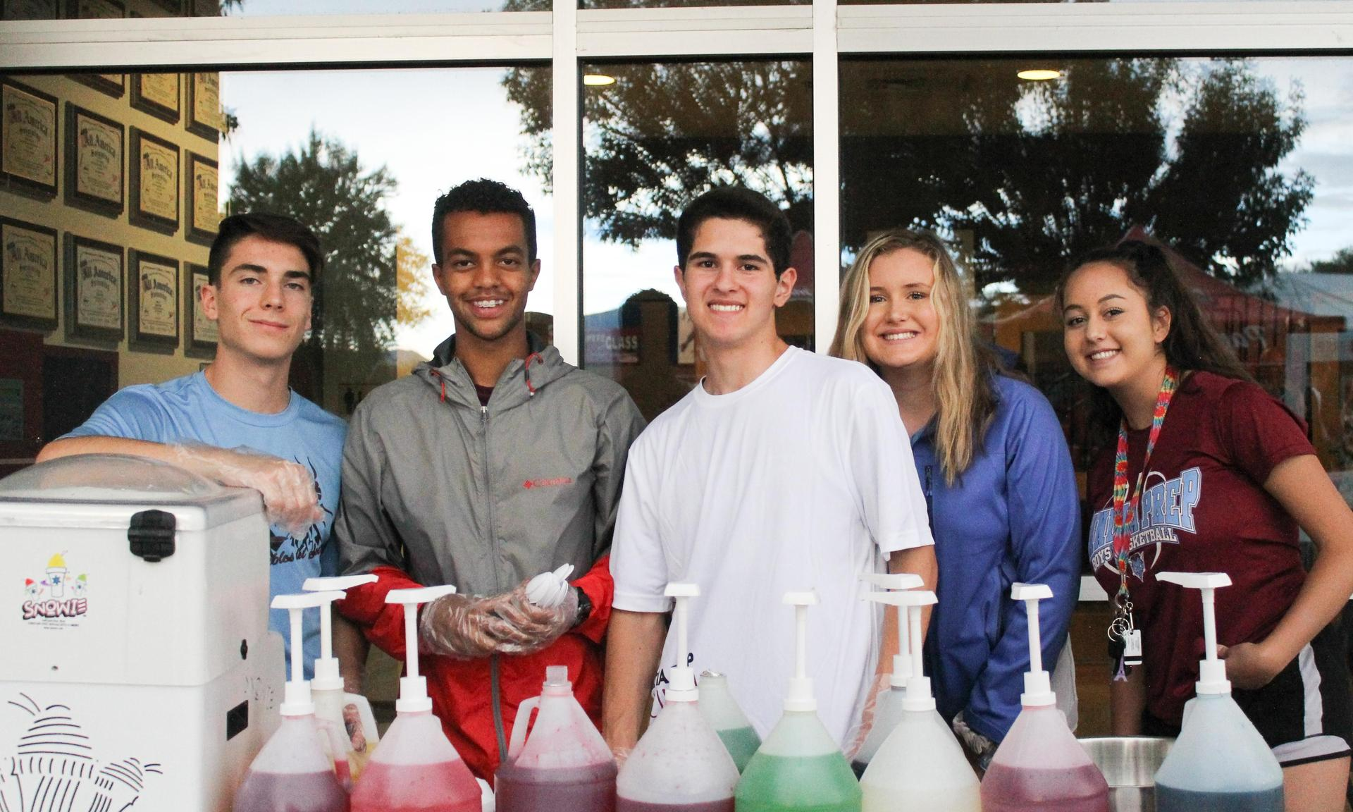 Students smile at the camera