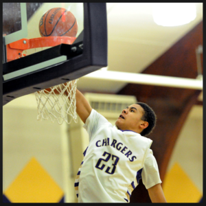 photo of Cameron Johnson shooting a basket in a basketball game with the OLSH Chargers