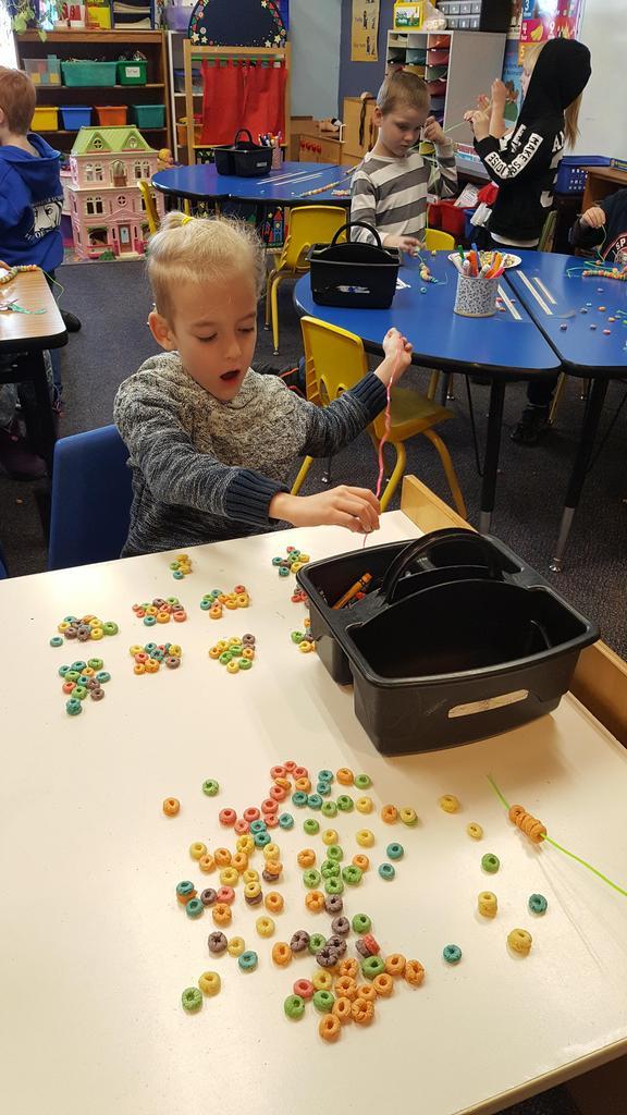 Boy Making 100 item Necklace