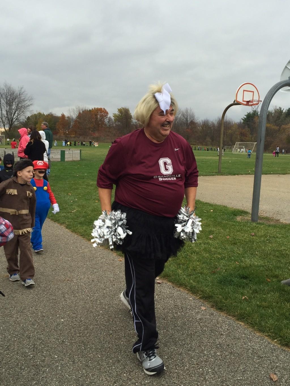 teacher in costume parade outside