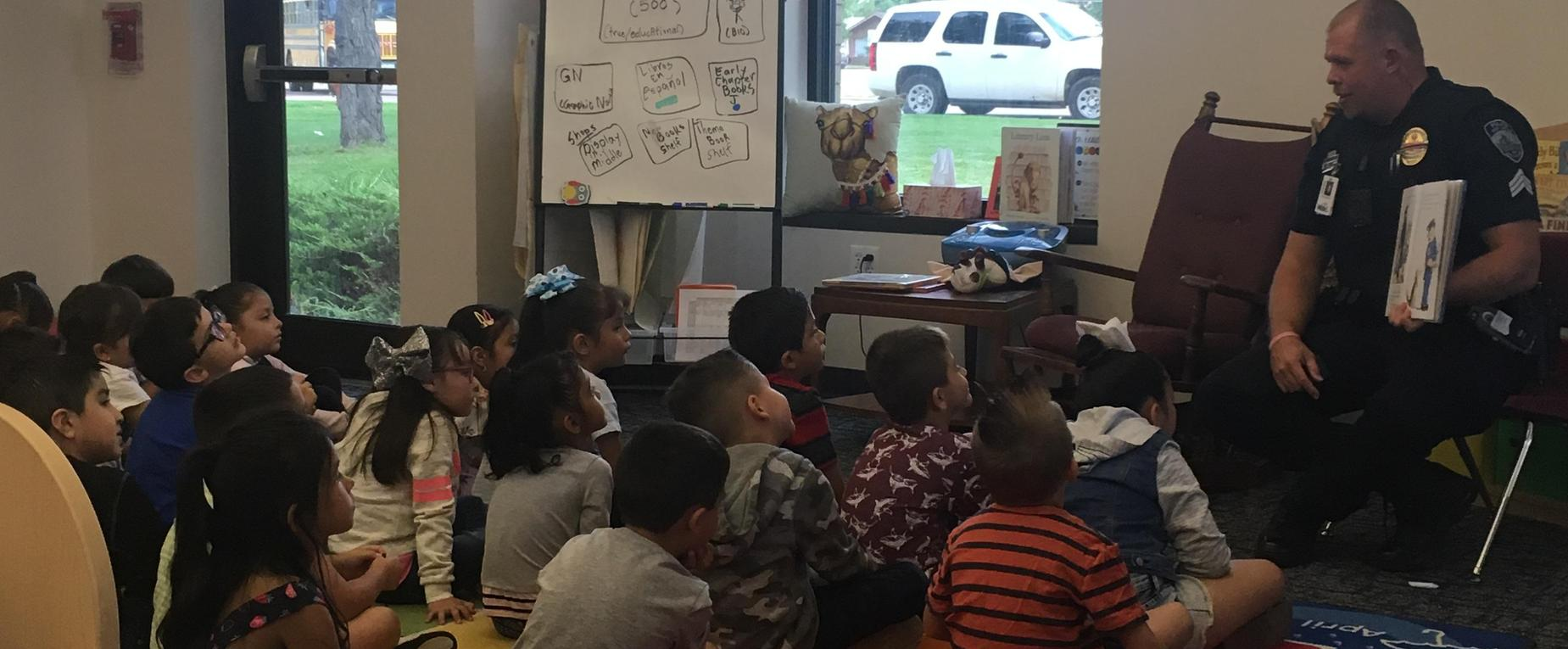 SRO Hemple Reads to Butler Students