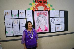 Dolores Huerta with artwork inspired by her and created by Grace Hudson Elementary students.