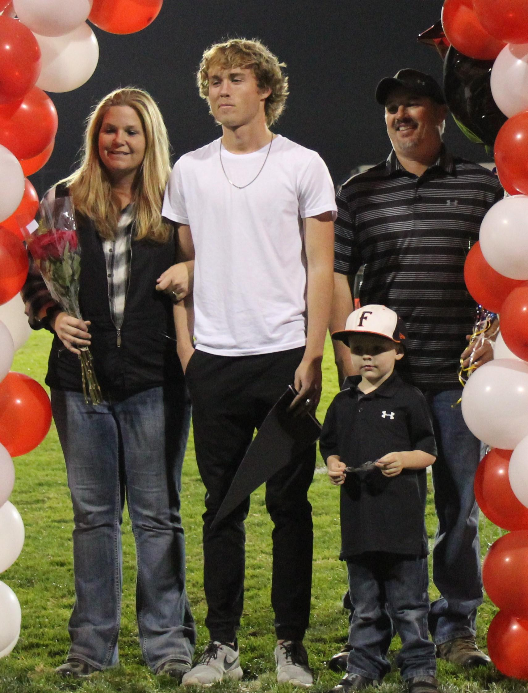 Kolton Stonier and his supporters at Senior Night.