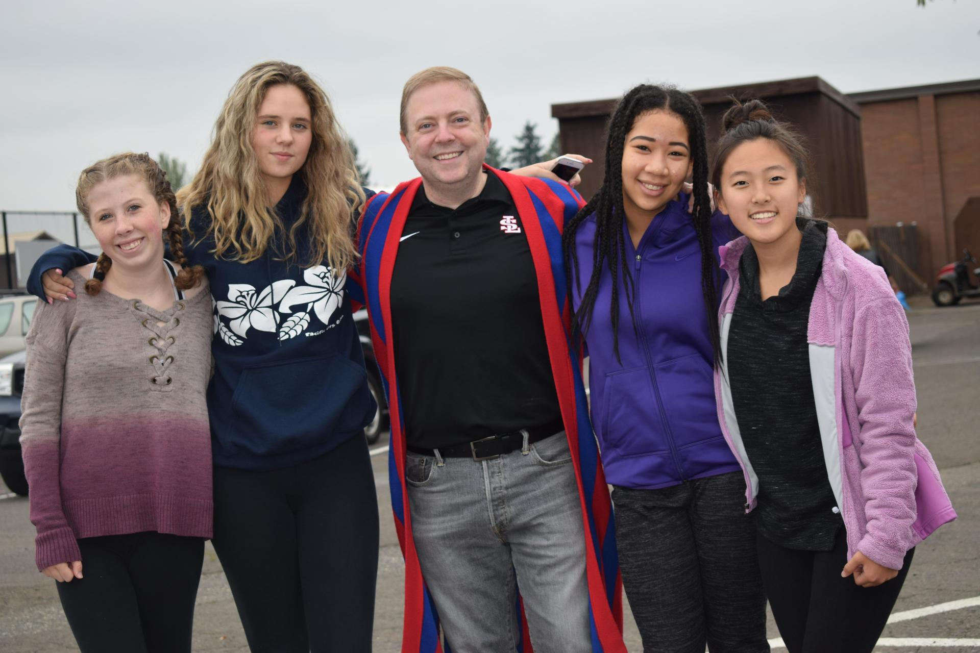 students pose with principal