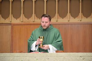 Priest delivering sermon