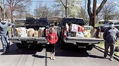 Photo of Jefferson parents and a student with truck of food donations.