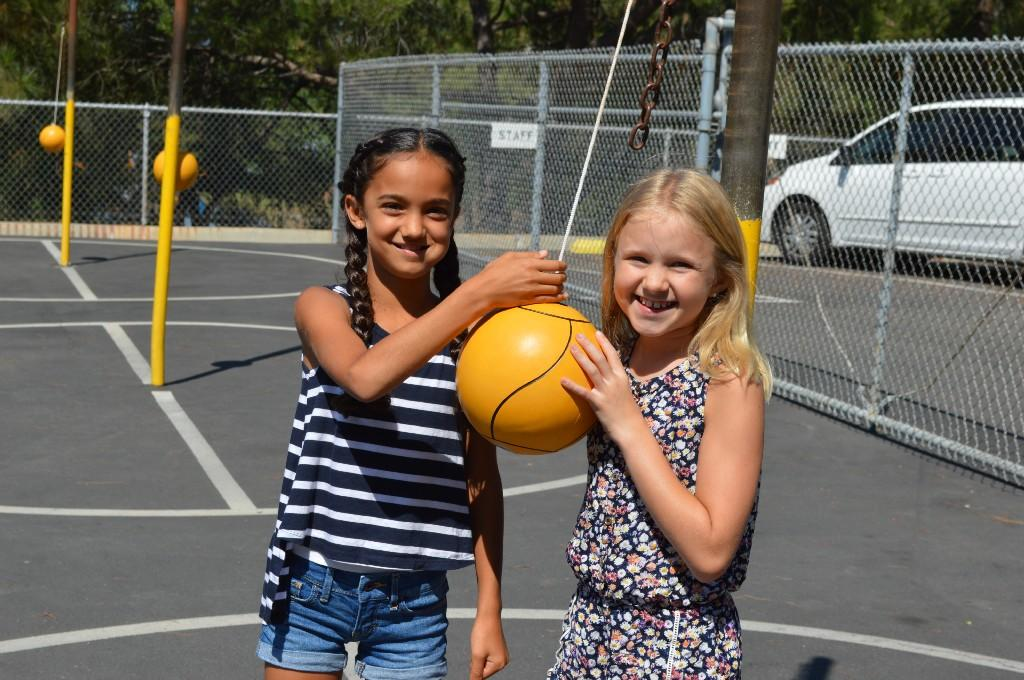 Students playing tetherball