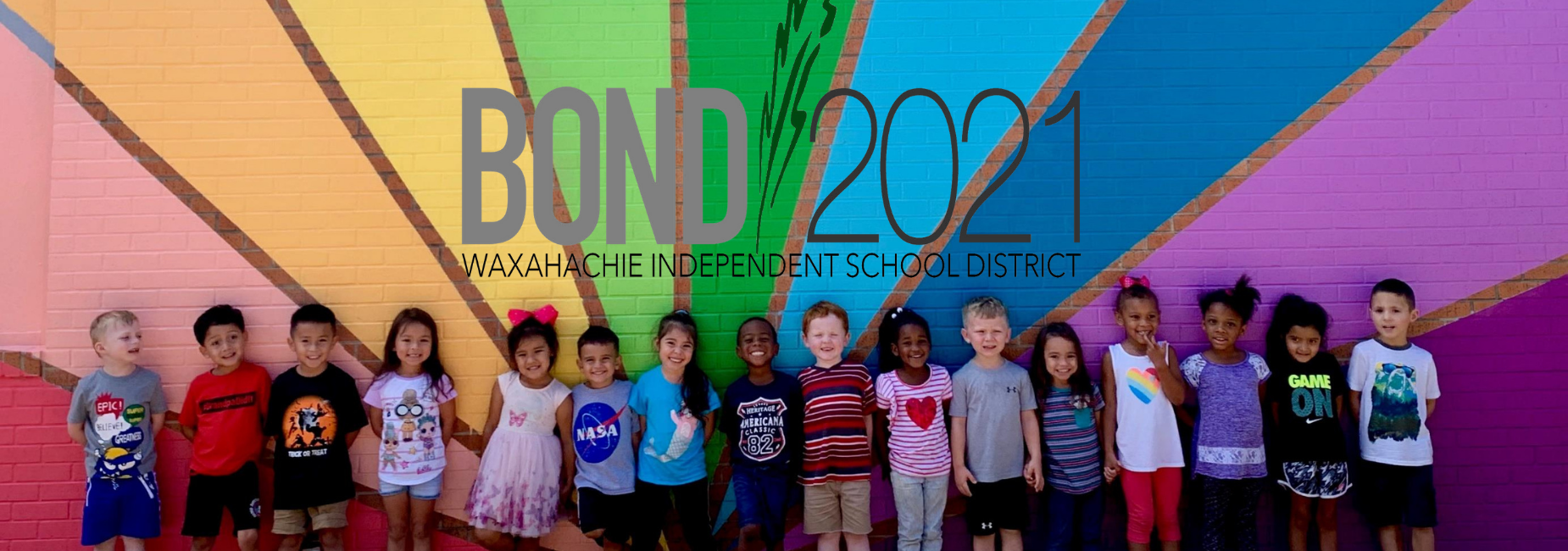 young kiddos in front of a colorfully painted wall with the WISD bond logo above them
