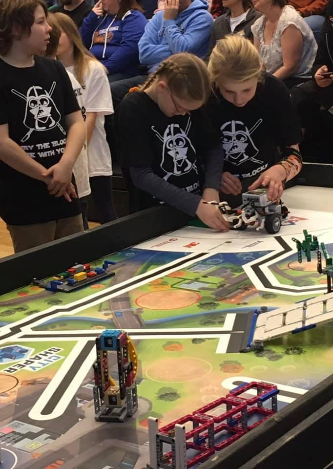 Group of children working on a robotics project