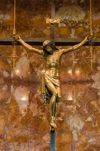 Statue of crucified Jesus Christ hangs above the altar at Christ the King church