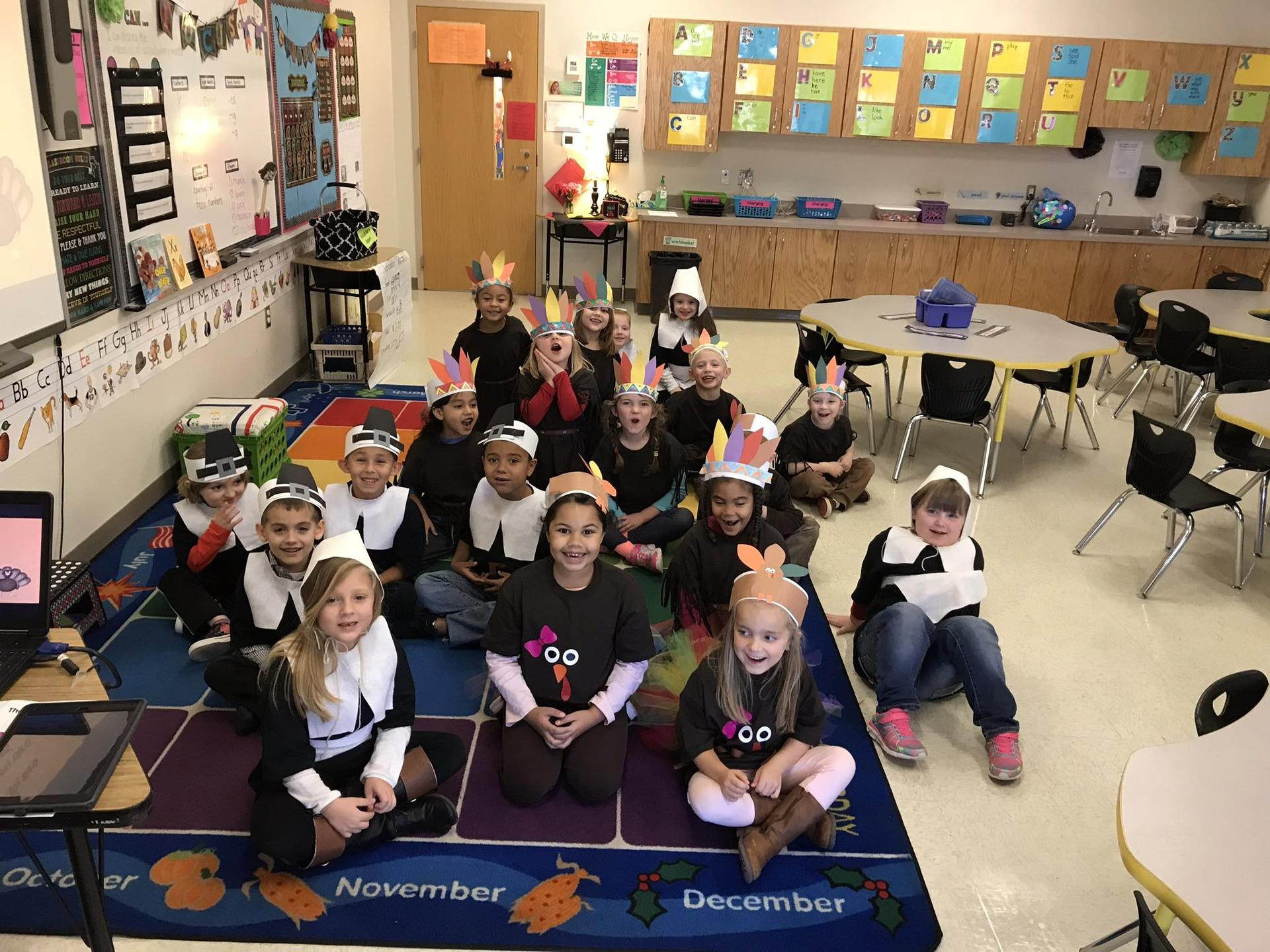 Kindergarten students dressed up as pilgrims and animals for Thanksgiving play.