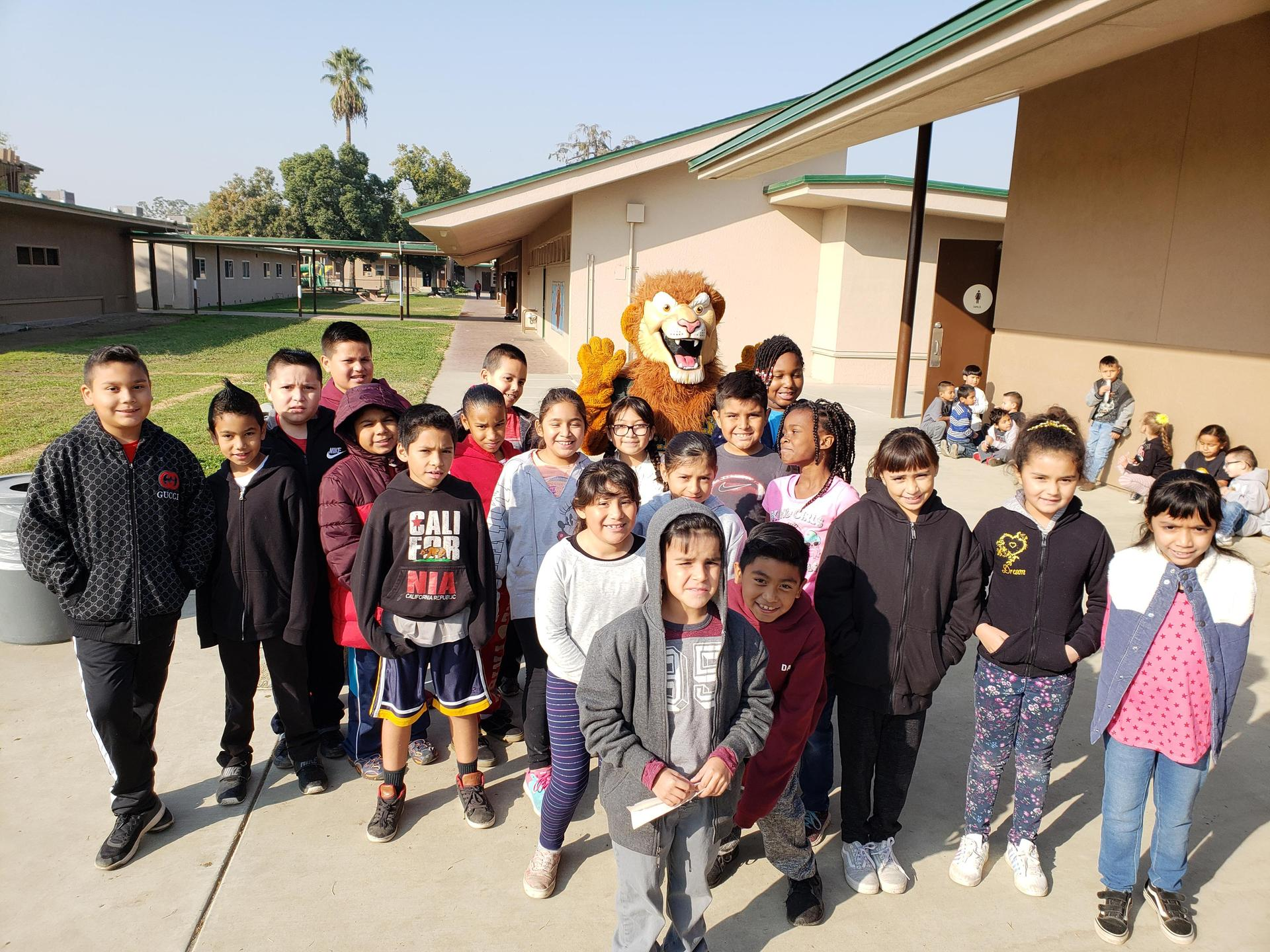 Students with Leo The Lion