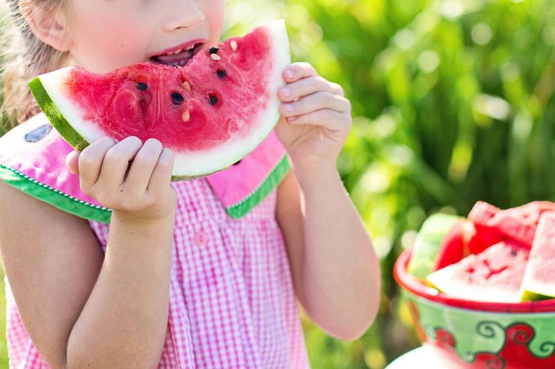 Image of a girl eating a watermelon
