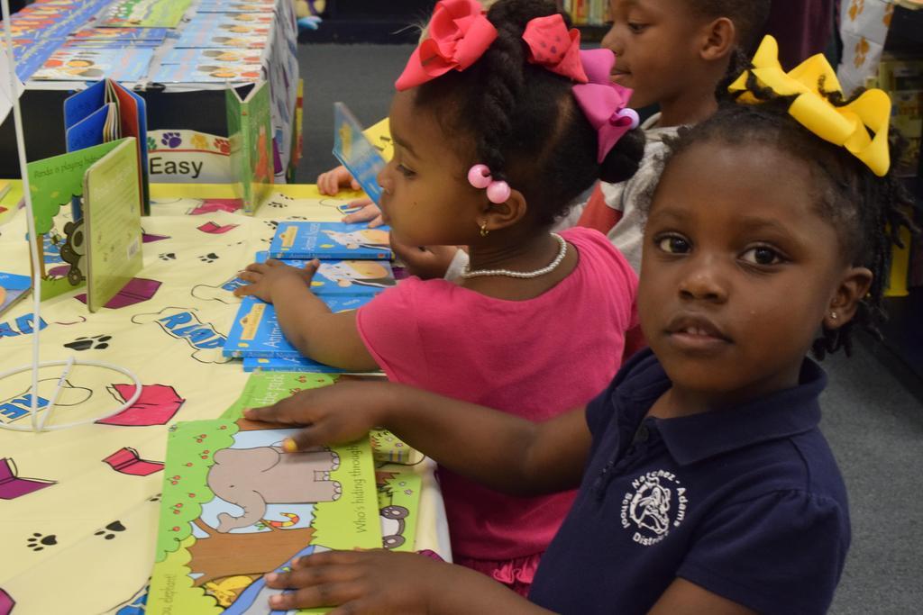 NASD Board meNASD Board member and Superintendent Give Students a Bookmber and Superi