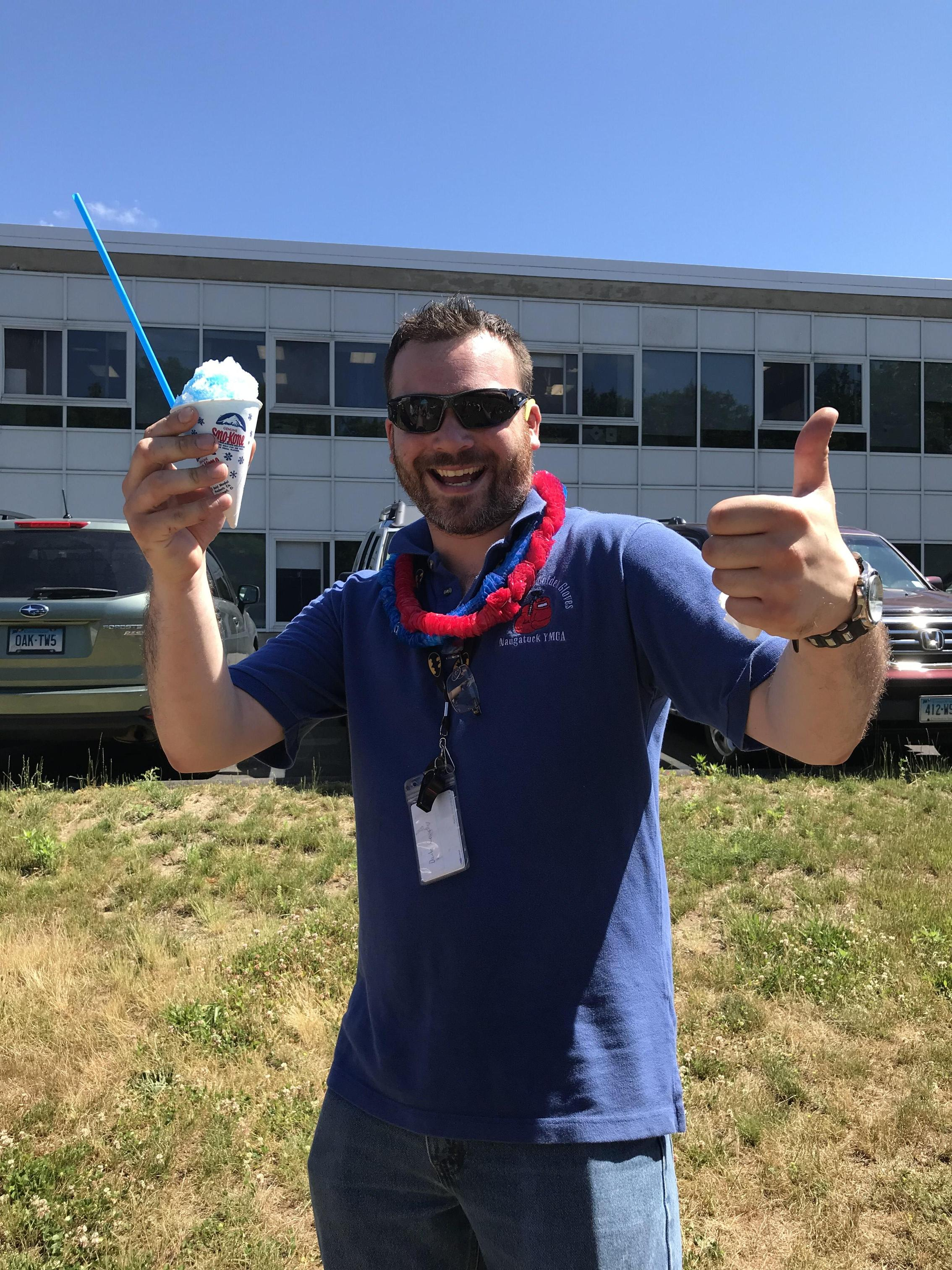 Mr. Coviello enjoys a snow cone.