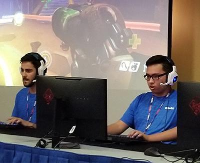 Two team members compete at a Boise State esports tournament.