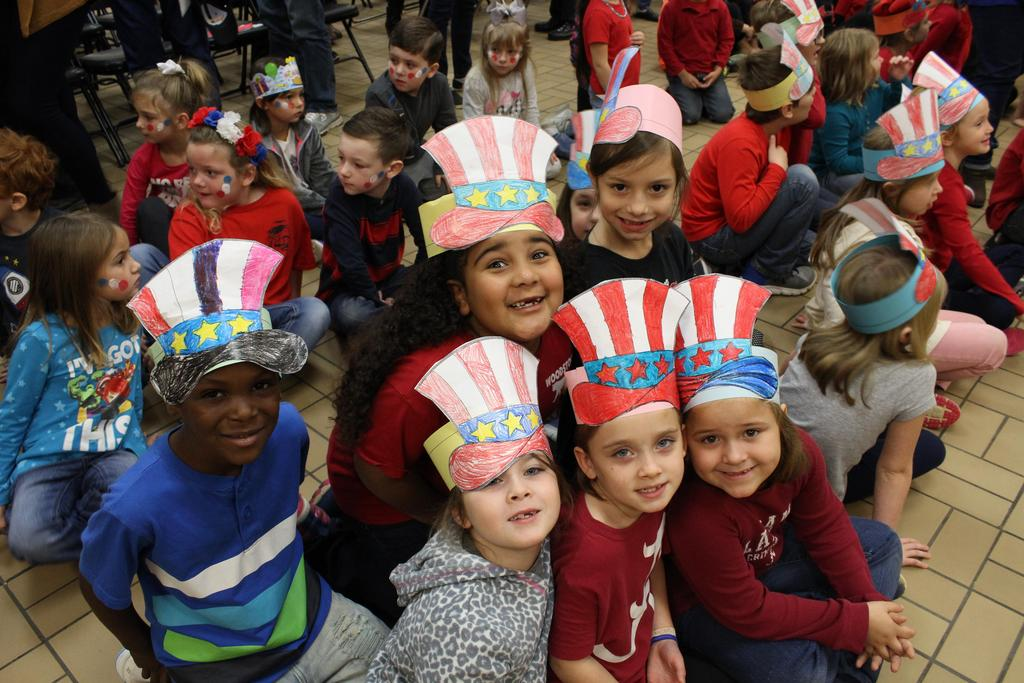 students with patriotic hats on