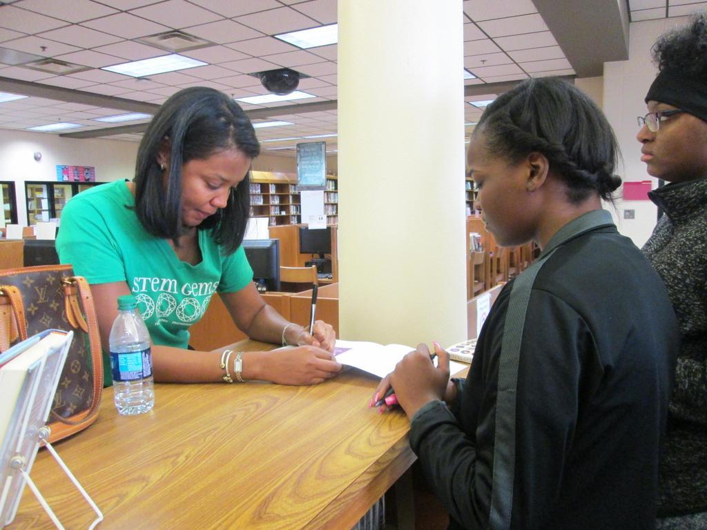 Stephanie Espy signs her book.