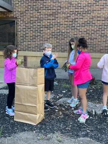Students working on the school grounds during Lorax project