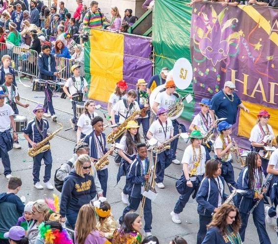 high school students marching band in Mardi Gras parade