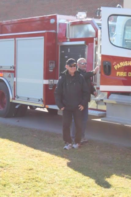 Coach getting off firetruck