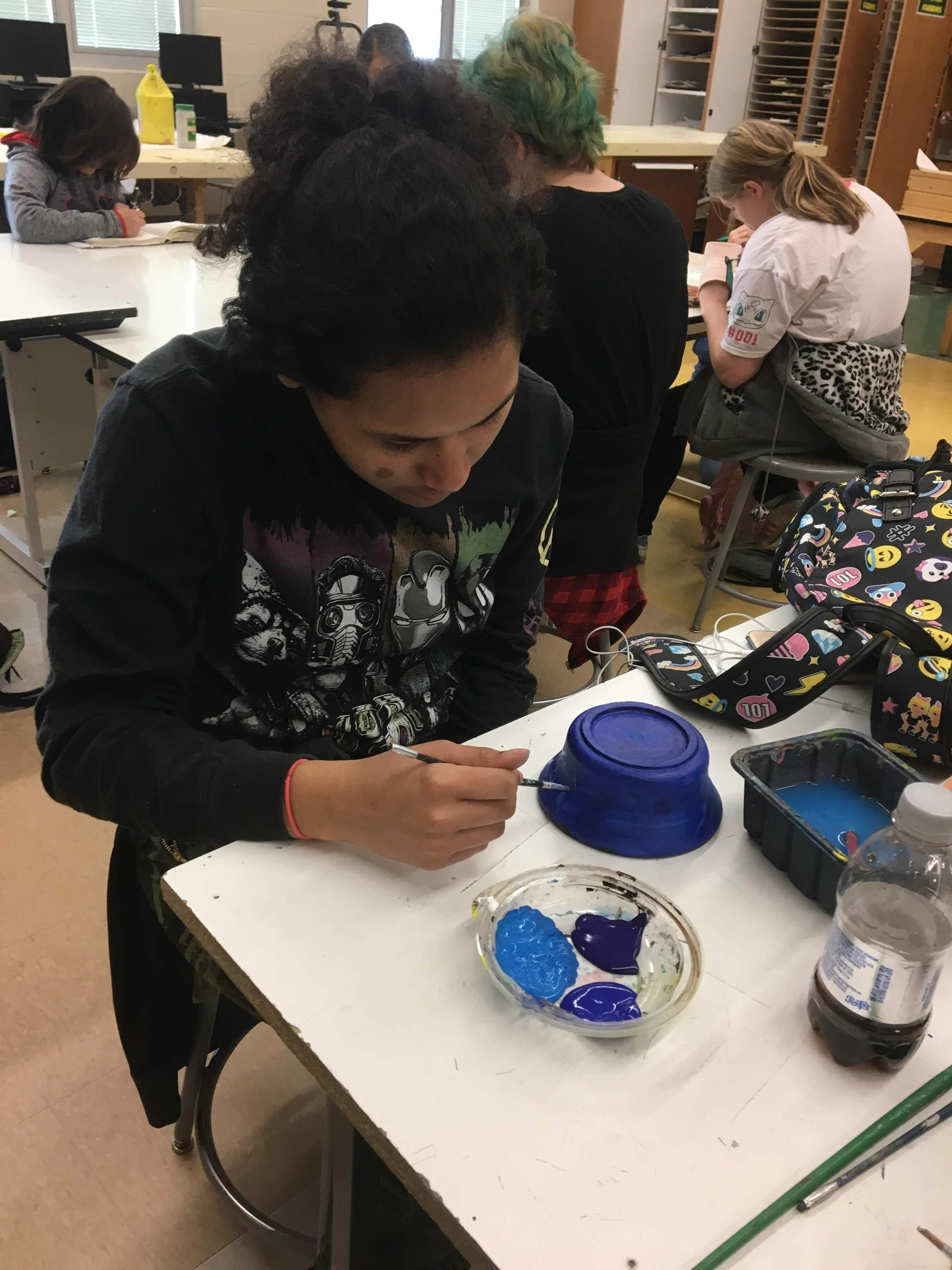 Student at work during Art Club on their project.