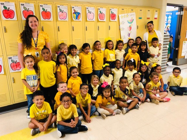 1st Grade teachers with students in all yellow for Homecoming Week