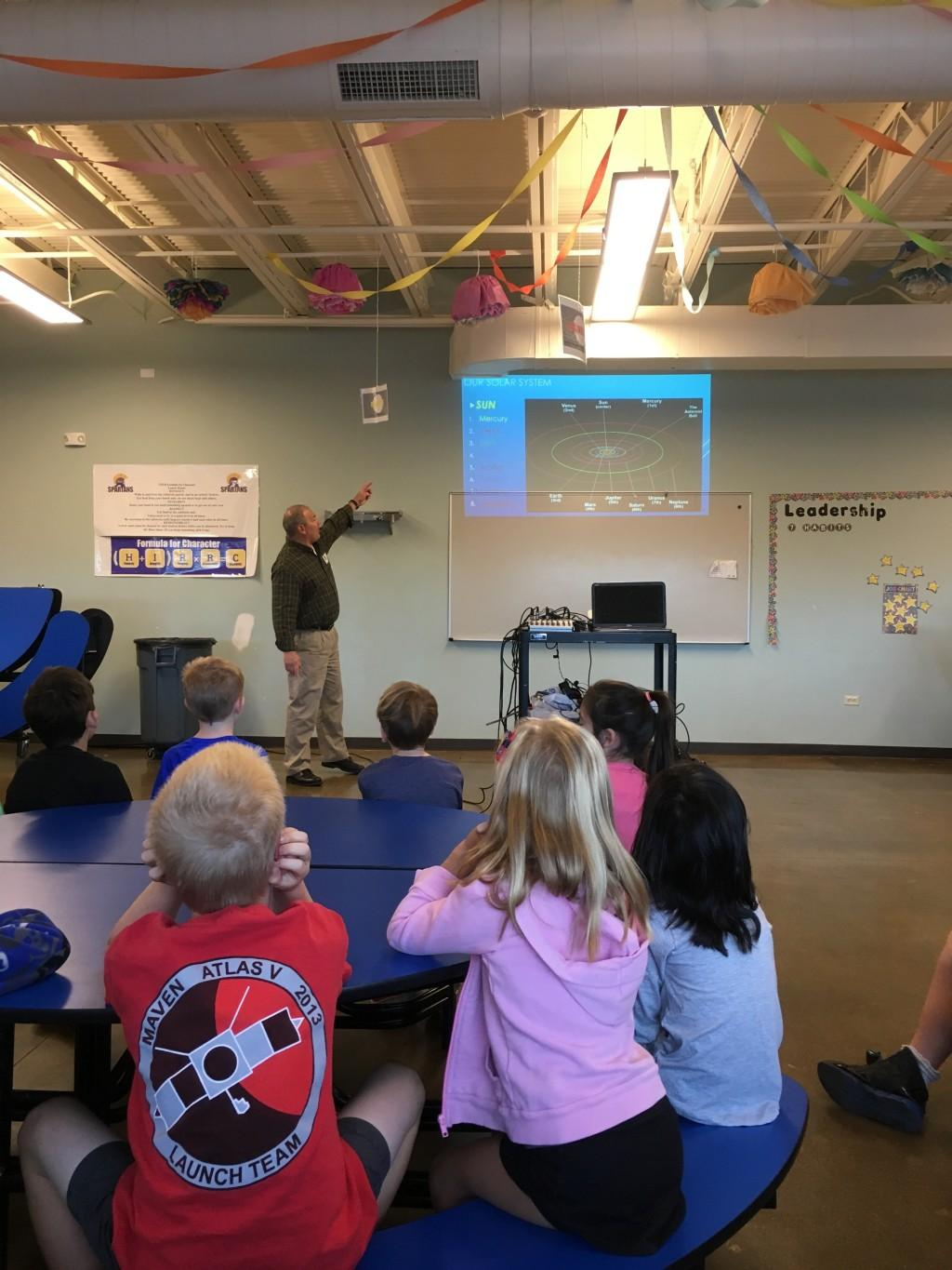 Guest speaker Ric Snow from Lockheed Martin explains the Orion program and NASA's Mission to Mars for 2nd graders.