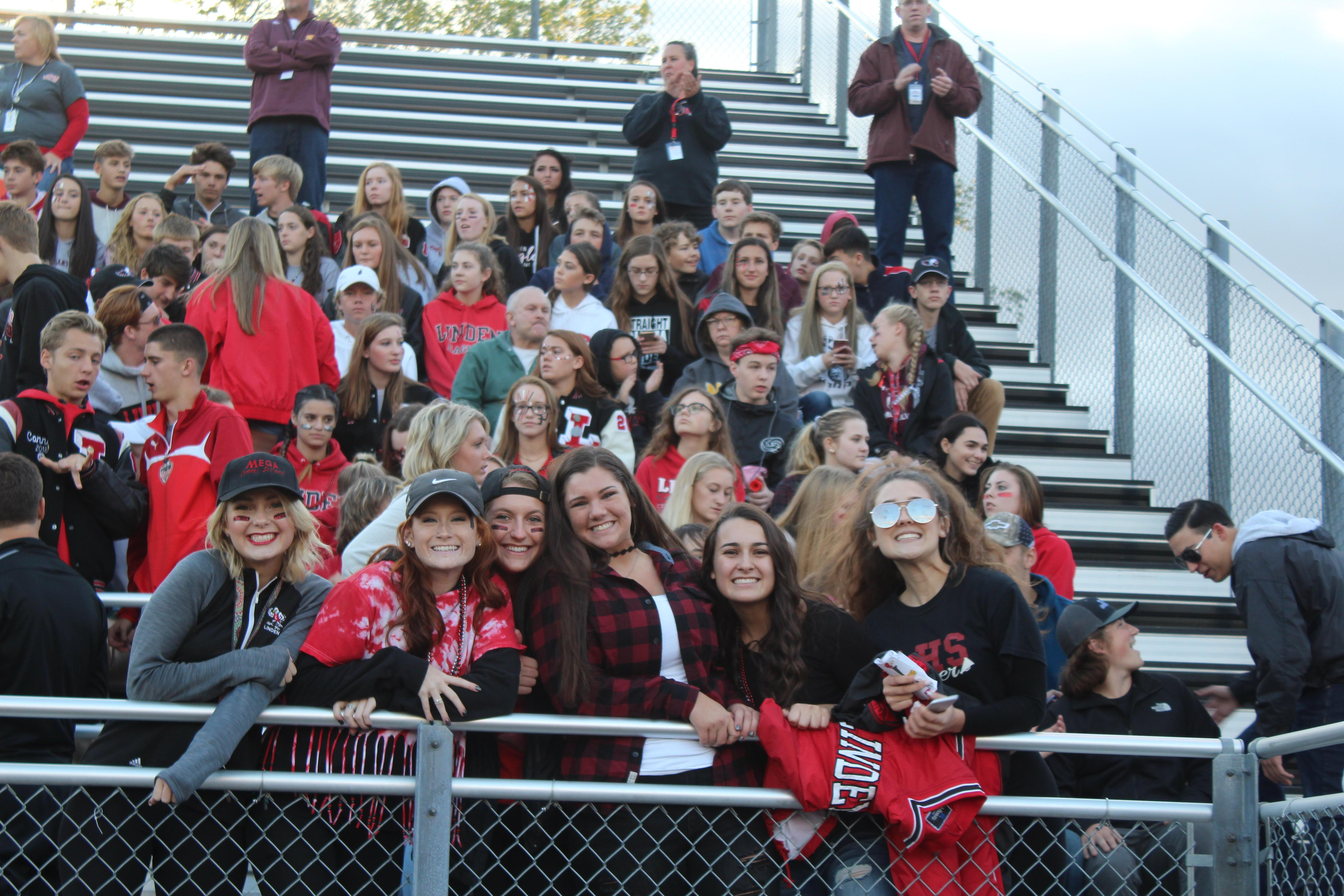Student section in bleachers at a football game