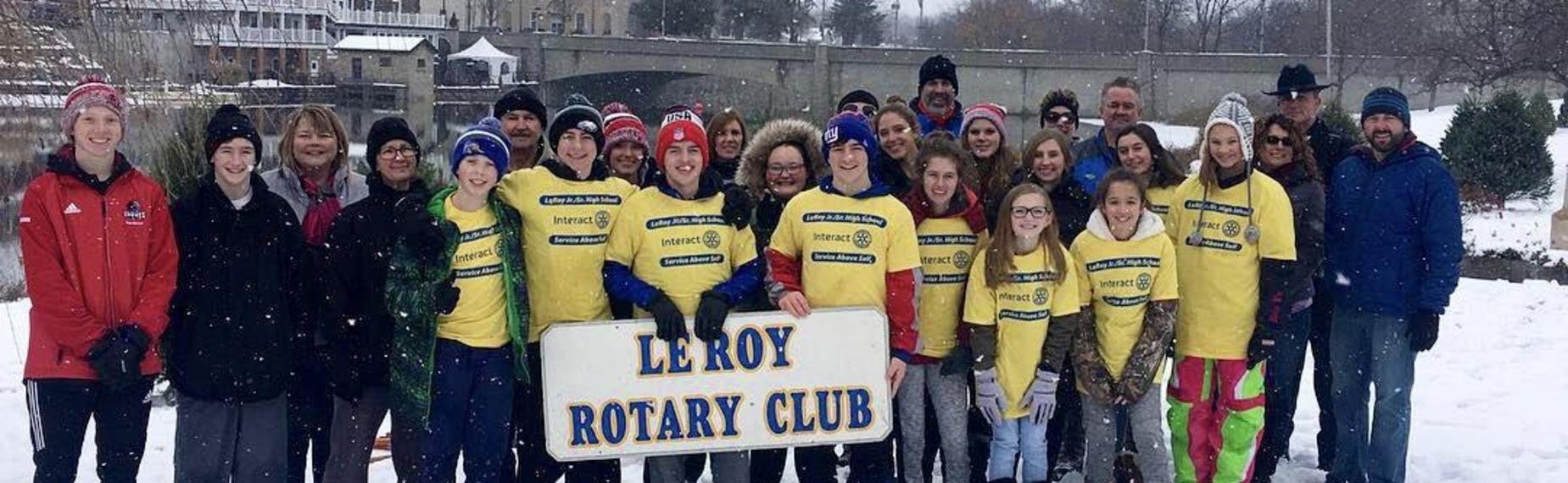Rotary Interact Club putting up Christmas trees on the creek bank