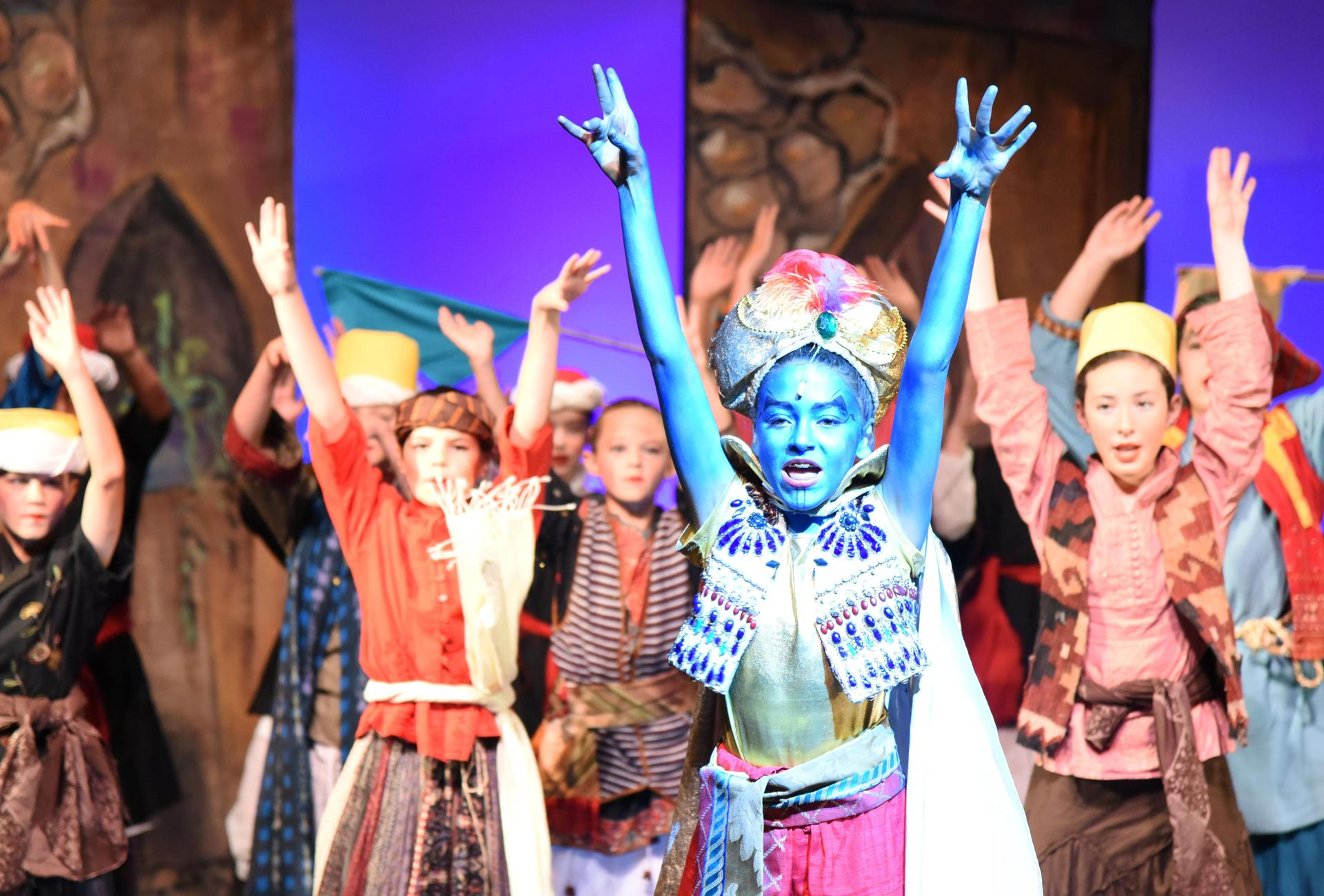 Middle school students perform a song and dance routine from Aladdin Jr.