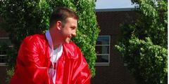 senior boy in red robes