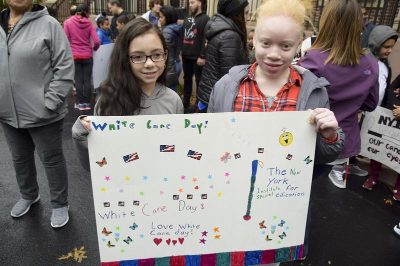 Two students with their White Cane Poster