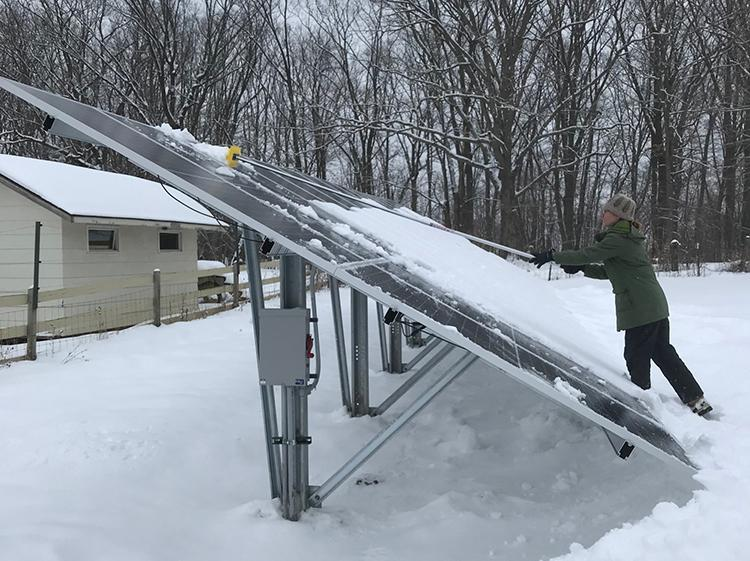 Staff clearing the solar panels