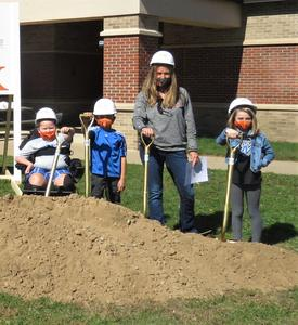 Lee principal and students take part in the groundbreaking ceremony.