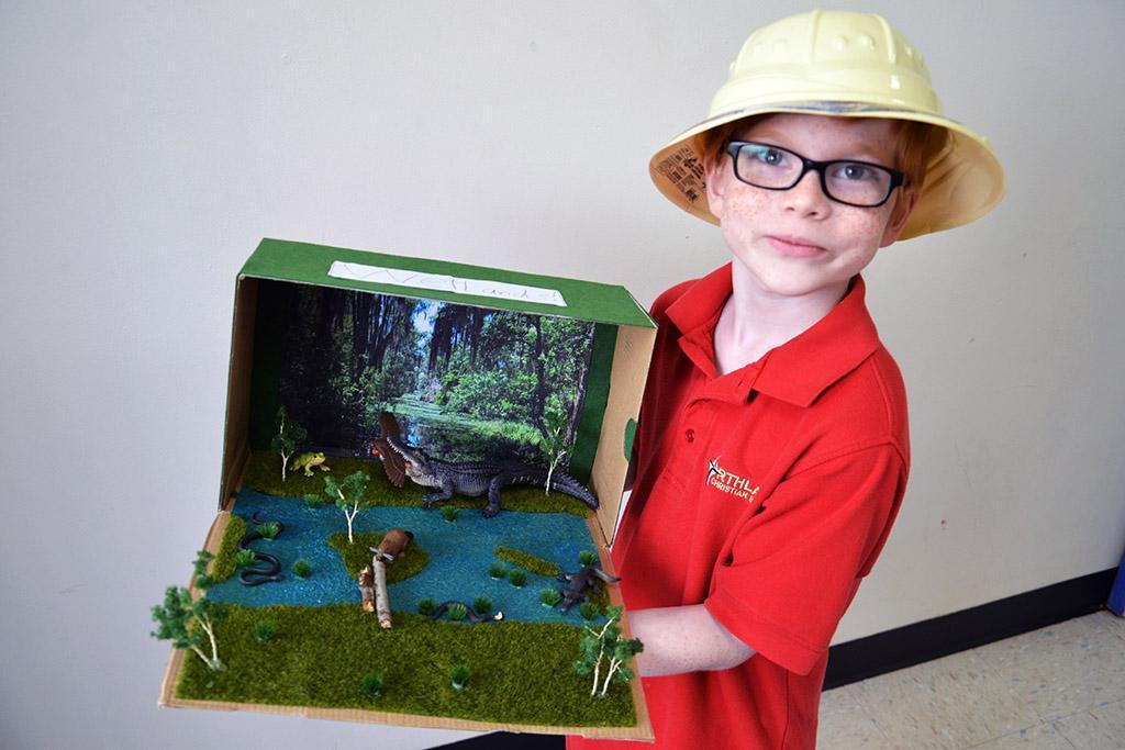 student with habitat
