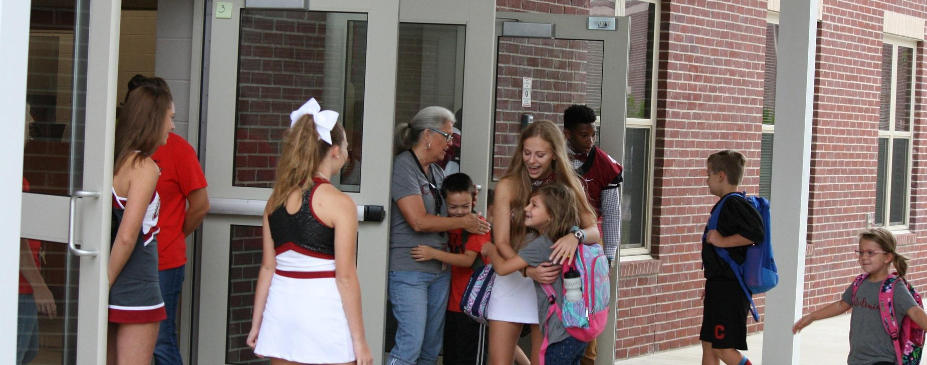 Caledonia High Cheerleader Greeting CES Student
