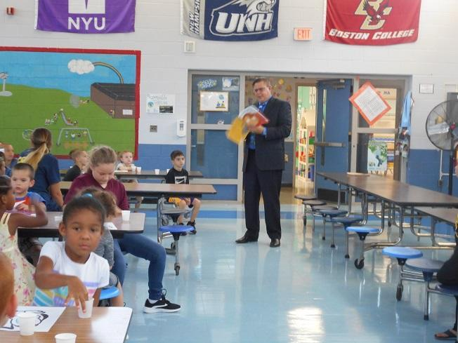 Mr. Gruber reads a book to the incoming K students