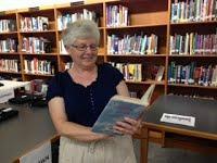 Ms. Trani reading a book