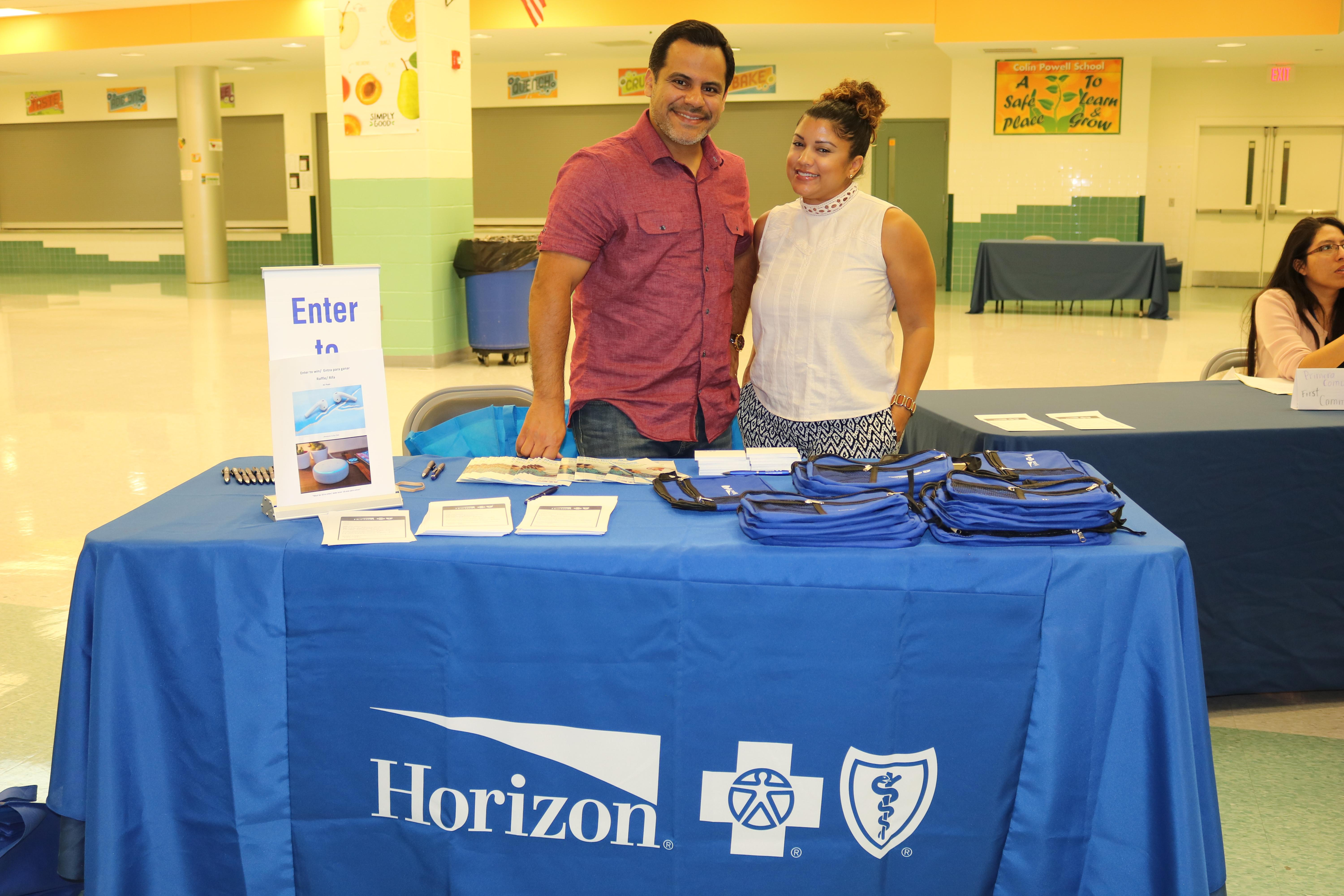 Horizon Representatives at the table with information and gifts